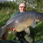 Simon Cooper with a lovely dark looking carp