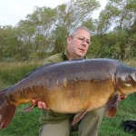 Simon Cooper with a stunning mirror carp