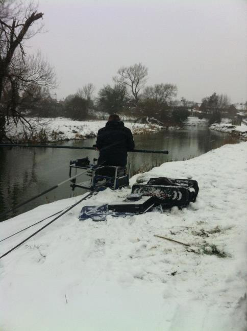 One of our loyal customers Pete Patton fishing in the snow! Real fishing weather!